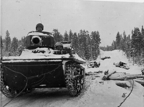 Finnish soldiers i towinga captured Soviet amphibious tank t-37A
