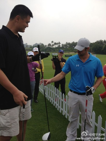 October 18th, 2012 - Yao Ming meets Michael Phelps at the Mission Hills World Celebrity Pro-Am Golf Tournament held October 19 to 21 in Haikou, Hainan Island