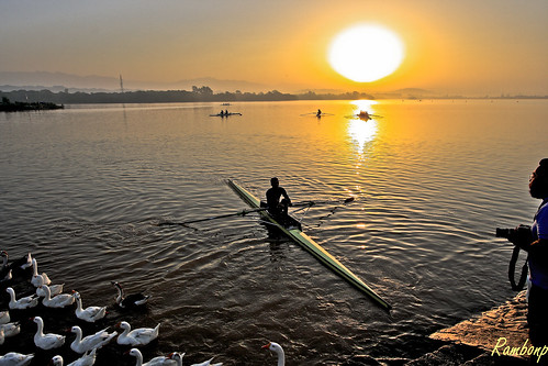 morning blue trees red wallpaper sky sun india lake mountains reflection green nature water birds yellow sunrise canon landscape boats boat paradise ducks hills boating ripples canoeing sunrays load sportsman chandigarh sukhnalake load3 load2 load1 उदयाचलatthecrackofdawnमुँहअँधेरे