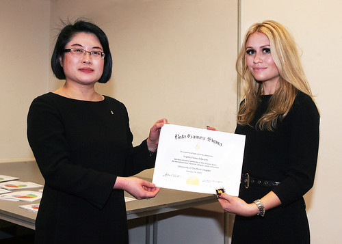 Professor Lenny Koh presents Sophie Edwards, BA Hons in Business Management, with her Beta Gamma Sigma membership certificate