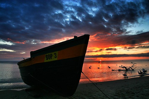 seamanmenoceanlakeriversunsunrisesunserviewoverredlandscapebeachsky boatboatsshipviewlandscape