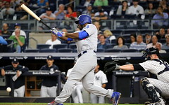 The Dodgers' Yasiel Puig fouls off a pitch in the first inning.