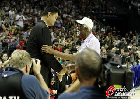 October 14th, 2012 -Yao Ming and Bill Russell meet before the Clippers-Heat exhibition game in Shanghai