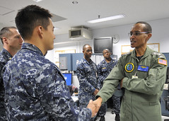 Adm. Cecil Haney shakes hands with Electronics Technician 2nd Class Matthew Han during a tour of Commander, Task Force 72 offices at Naval Air Facility Misawa. (U.S. Navy photo by Mass Communication Specialist 2nd Class Pedro A. Rodriguez)