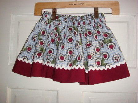 Strawberry print with red band and rick rack