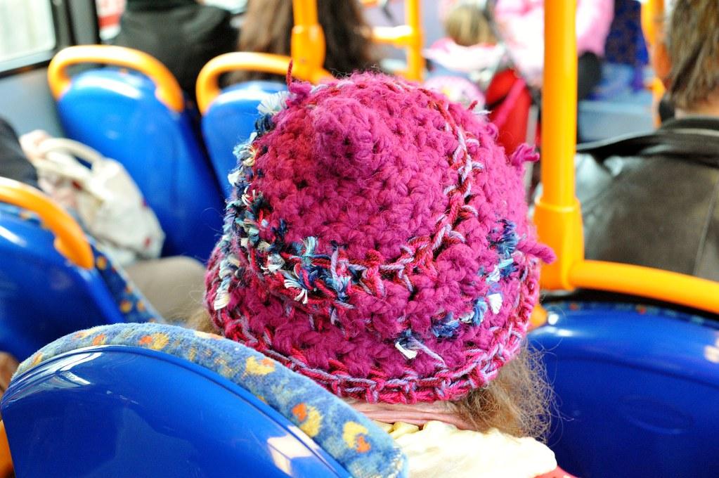 A weird hat on a 315 bus.