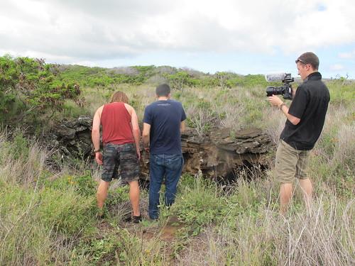 Exploring a lava Tube near Kamilo Beach, Hawaii