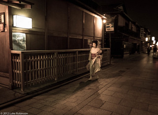 Geisha Suzuko hurries through Gion, Kyoto