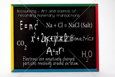 mathematical and scientific formulas written on slate board