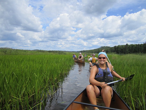 Wilderness Inquiry staff member Emily Walz leads a group in the Boundary Waters Canoe Area on the Superior National Forest, Minnesota
