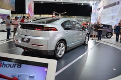 city car(0.0), automobile(1.0), automotive exterior(1.0), exhibition(1.0), wheel(1.0), vehicle(1.0), automotive design(1.0), auto show(1.0), chevrolet volt(1.0), concept car(1.0), sedan(1.0), land vehicle(1.0),
