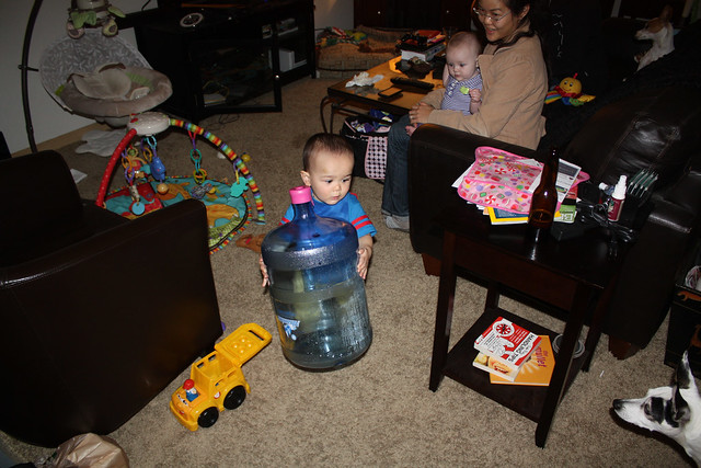 Playing with his water bottle drum