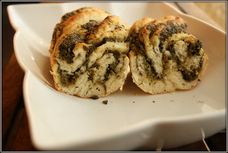 pesto bread in half