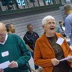 12-076 -- Ted Chase '54 and Mary Scott '53 sing the Cheer Song at the end of the Alumni Awards Luncheon.