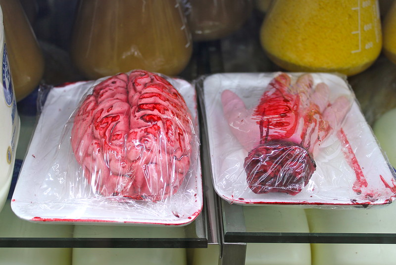Brains and severed hand in cling-wrap
