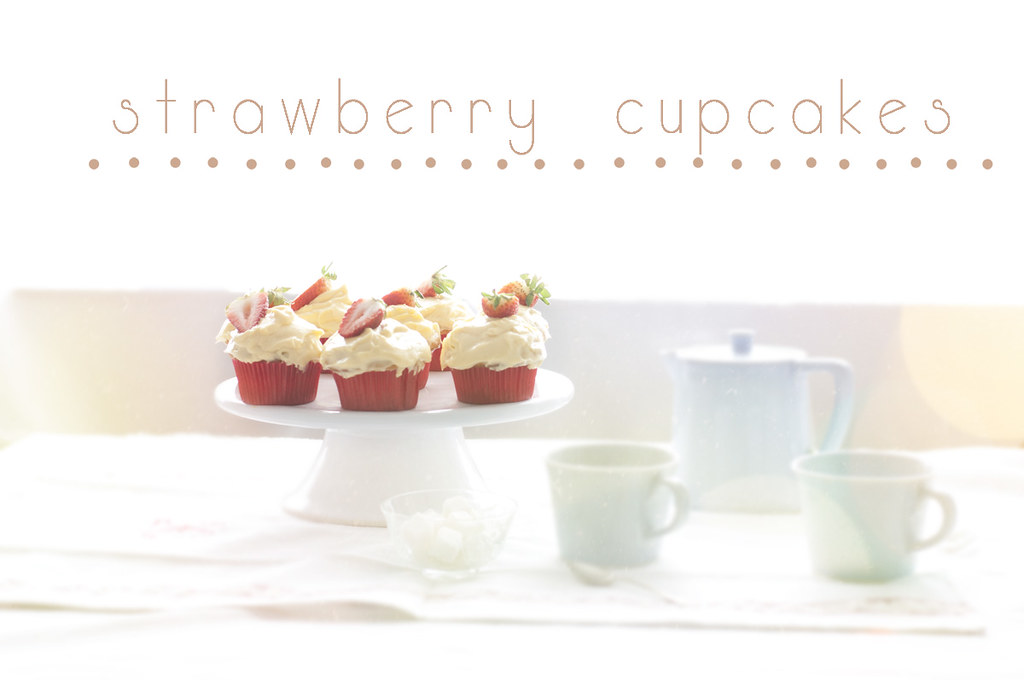 Vanilla Cupcakes with a Custard Topping and Strawberry Jam Filling