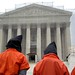 Close Guantánamo: Hooded protestors outside the Supreme Court