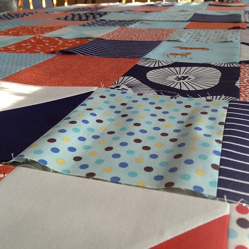 Sunday morning, laying out rows for a quilt top.