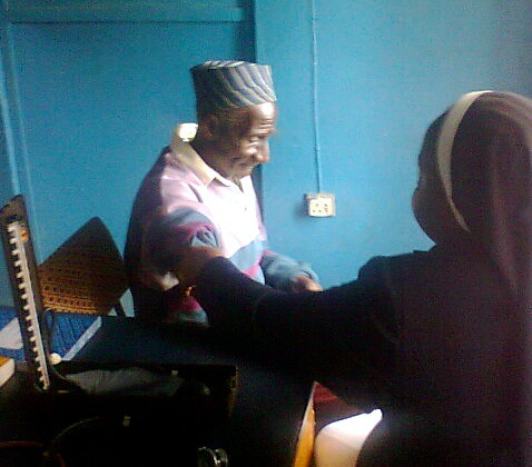 Matron of St Louis Hospital in Zonkwa, Cecilia Olusanya SSL, attending to a patient in the Outpatients Department