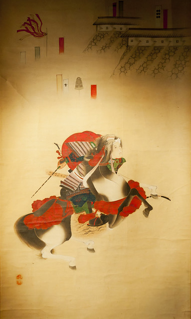 Samurai horseman on old vintage japanese traditional painting