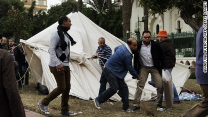 Supporters of the Muslim Brotherhood and the Morsi government tear down tents erected by the opposition forces in Cairo. Clashes erupted on December 5 resulting in two reported deaths. by Pan-African News Wire File Photos
