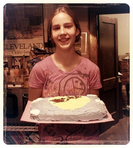 Izzy holding her Santa Cake!