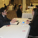 IWU student Tung Hoang interviewing with a recruiter from Aon Hewitt Benefits Consulting Firm --