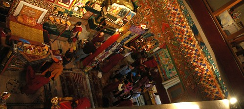 After the initiation and prayers, monks attend to the lama's table, sangha chats about religion and spirituality, traditional decor, Tharlam Monastery of Tibetan Buddhism, Boudha, Kathmandu, Nepal by Wonderlane