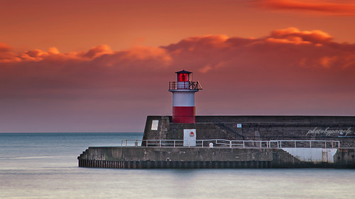 red lighthouse seascape architecture sunrise pier harbour getty wicklow gettyimages irishsea