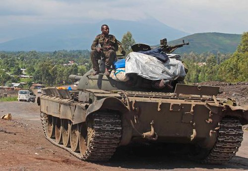 Democratic Republic of Congo soldier sits on an army tank outside the eastern city of Goma on November 19, 2012. The city was reportedly siezed by M23 rebels with very little resistance. by Pan-African News Wire File Photos