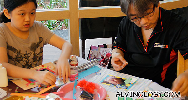 Father and daughter pair working on their photo frames