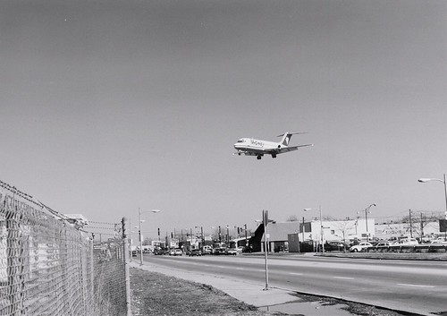 Midway Airlines jet landing at Chicago's Midway Airport. (Defunct)  Chicago Illinois.  April 1990. by Eddie from Chicago
