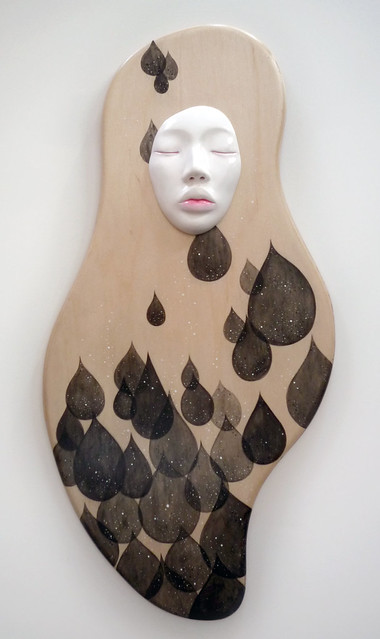 "Chrysalis. 12"" x 23"". Acrylic & Clay (Face) on Wood. © 2012."