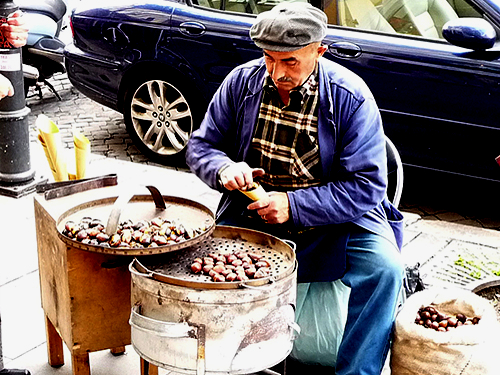 One of those satisfying moments while travelling, is watching a man in his small stall roasting chestnuts on the streets of Paris. An even better  travel experience is to getting in an try the freshly roasted food and talk to the stallholder.