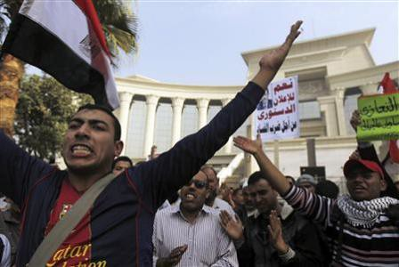 Muslim Brotherhood members outside the Egyptian Supreme Court demonstrating their support for the decrees and draft constitution issued by President Morsi. by Pan-African News Wire File Photos