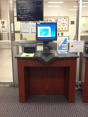 Self-check machines are next to the lower level lobby doors.