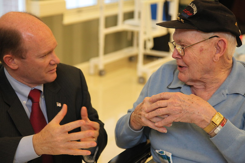 Senator Coons talks with veteran Thomas Morris