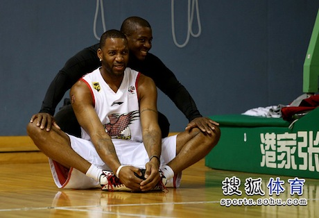 October 26th, 2012 - Tracy McGrady stretches before his first practice with his new team in Qingdao, China