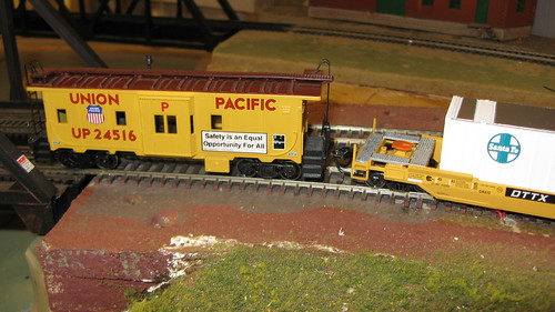 H.O Scale  Union Pacific bay window caboose trails an intermodal train. by Eddie from Chicago