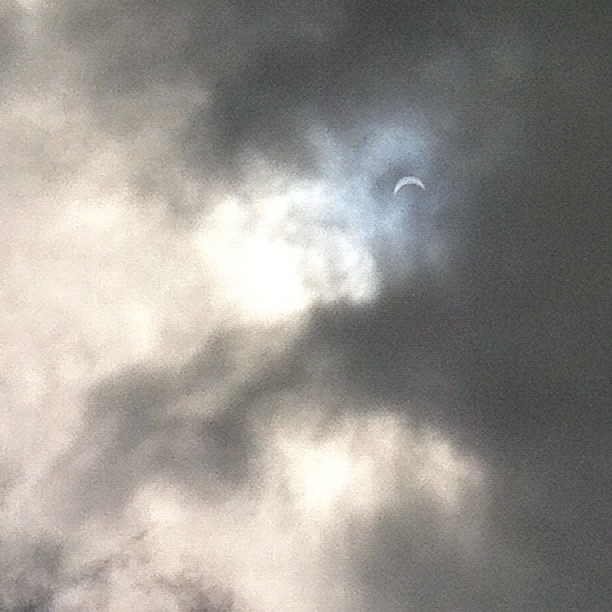 Partial solar eclipse. I've been watching it with the classic pinhole in a piece of cardboard but couldn't resist taking a photo through some cloud that came over. All very exciting! #eclipse #solareclipse #auckland #sun #cloud