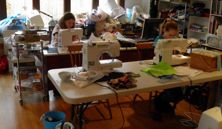 Happy kids sewing