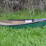canoe busted from river rapids