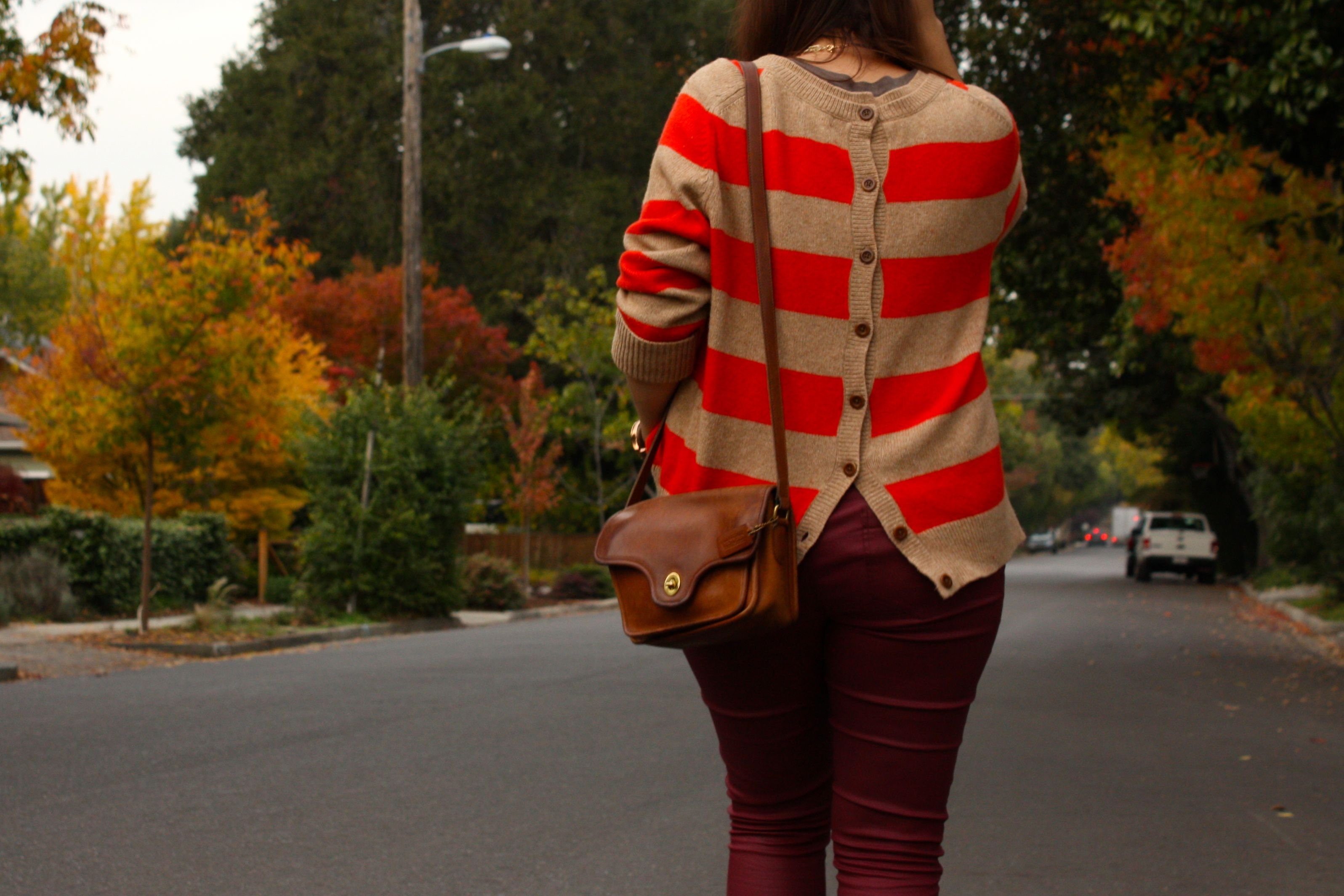 burgundy waxed jeans with orange striped lands end sweater and brown coach bag plus glitter booties01