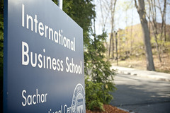 An image of the Brandeis International Business School signage outside of the Brandeis IBS building