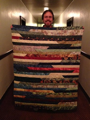 Zach's new quilt top. I am going to add some borders so it will fit my tall husband better.