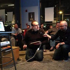 Drawing lessons at the Sketchnote Handbook launch party. I'm using Penultimate and a stylus with my iPad 2.Len Kendall holds the mic. Photo by Mark Fairbanks.