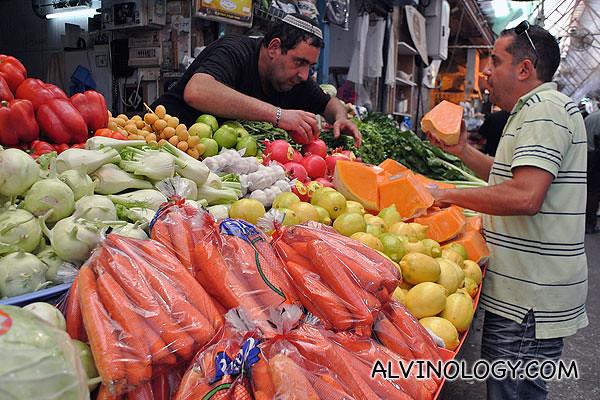 A guy buying fruits