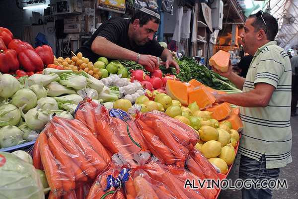 A guy buying fruits