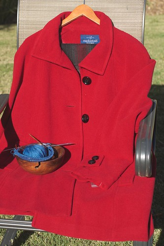 red coat and blue yarn
