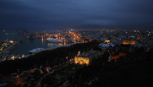 Malaga seafront and Ayuntamiento at night, from Gibralfaro